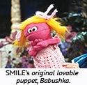 SMILE's original lovable puppet, Babushka.